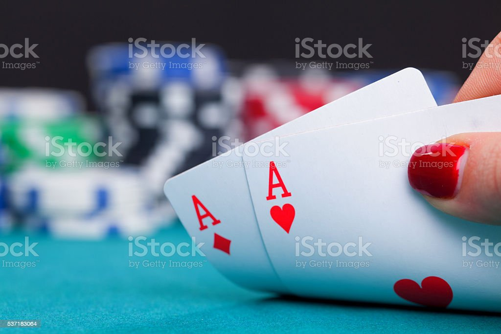 Two aces and gambling chips stock photo