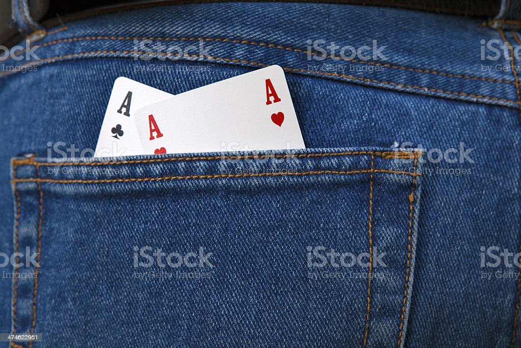 Two aces in gambler's jeans pocket stock photo