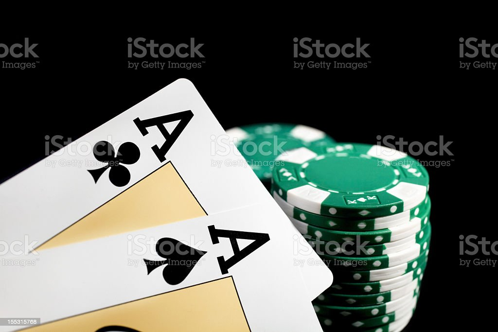 Two aces in hand and green chips on the table royalty-free stock photo