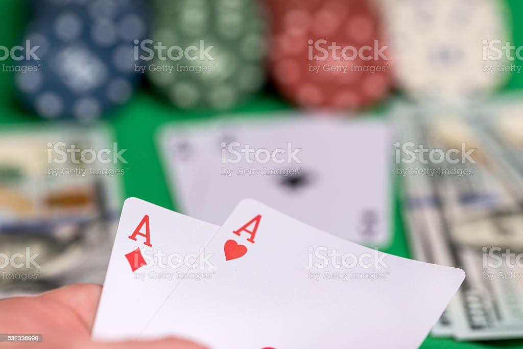 two aces in hand with poker card, chips  and money stock photo