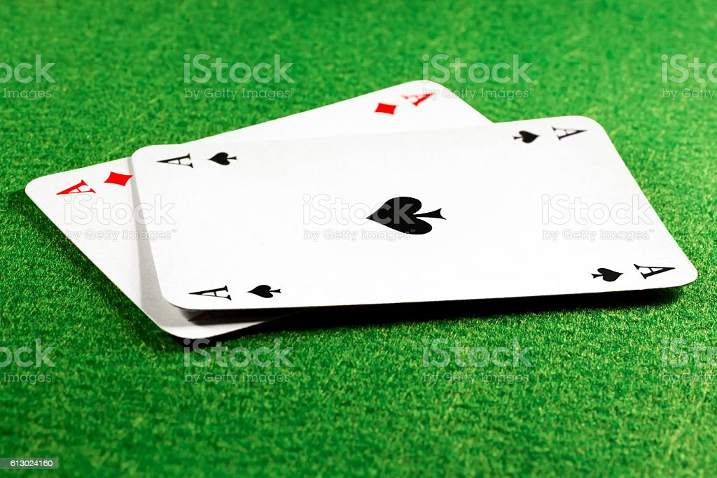 Two aces on green felt casino table stock photo