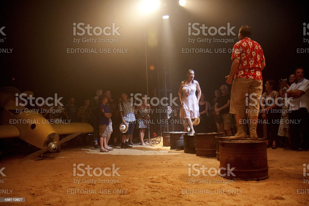 Two actors on big cans. stock photo