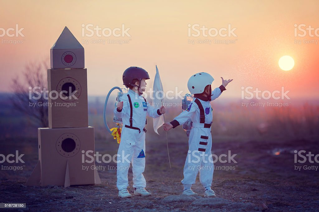 Two adorable children, playing in park on sunset stock photo