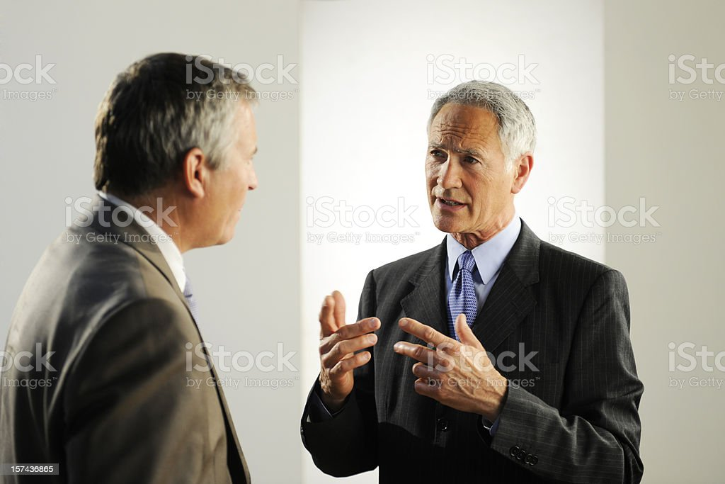 Two adult business men in conversation royalty-free stock photo