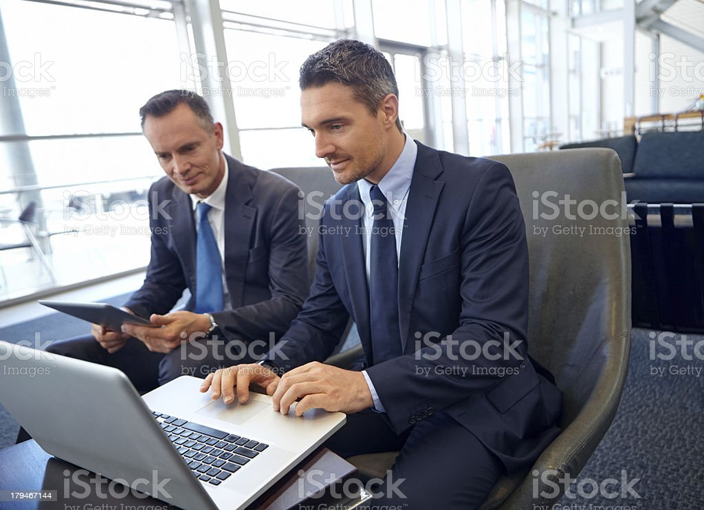 Two adult businessmen looking at a laptop screen royalty-free stock photo