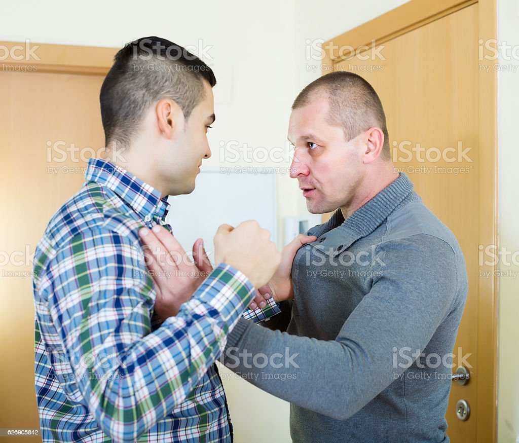 Two adult men having fight stock photo