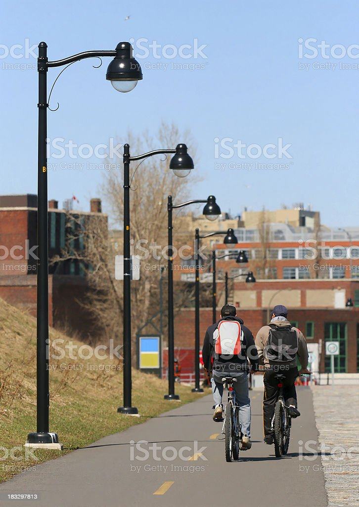 Two adults in urban bicycle ride royalty-free stock photo