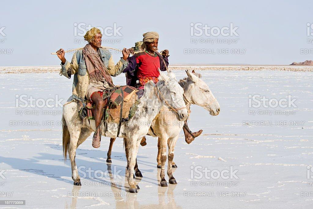 Two Afar men riding on donkeys in Danakil Desert, Ethiopia stock photo