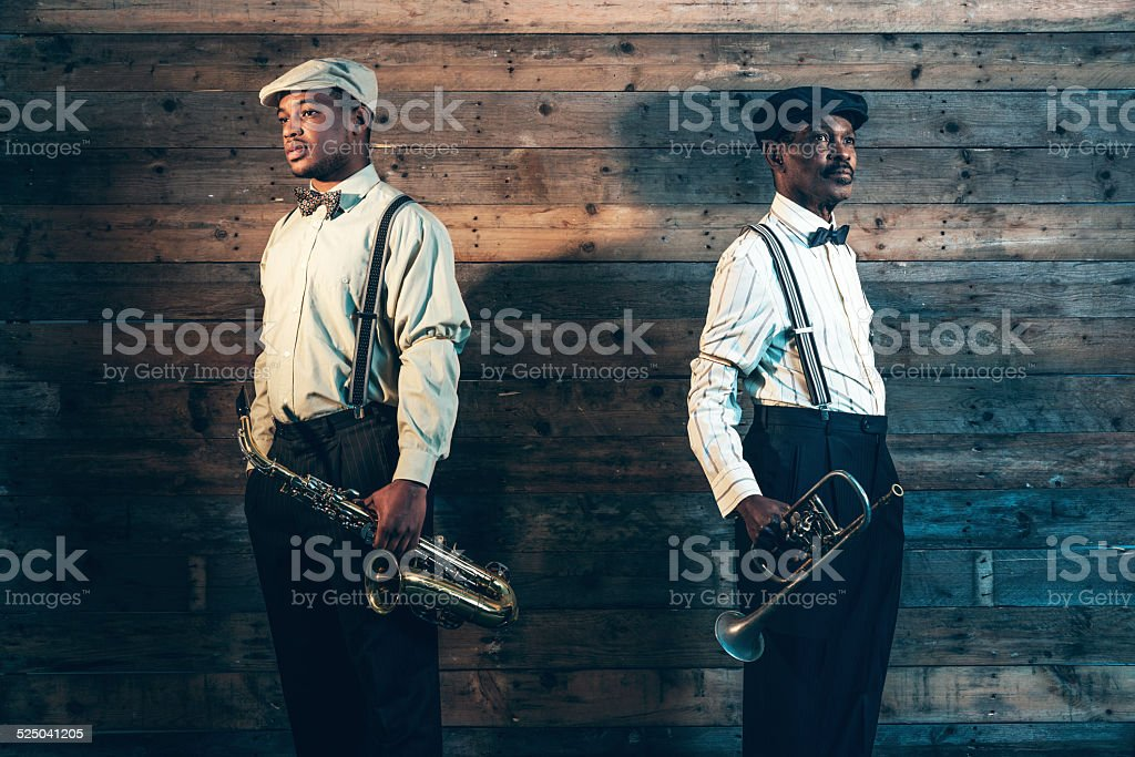 Two african american jazz musicians with trumpet and saxophone. stock photo