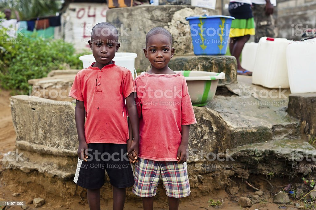 Two African Boys By Water Pump royalty-free stock photo