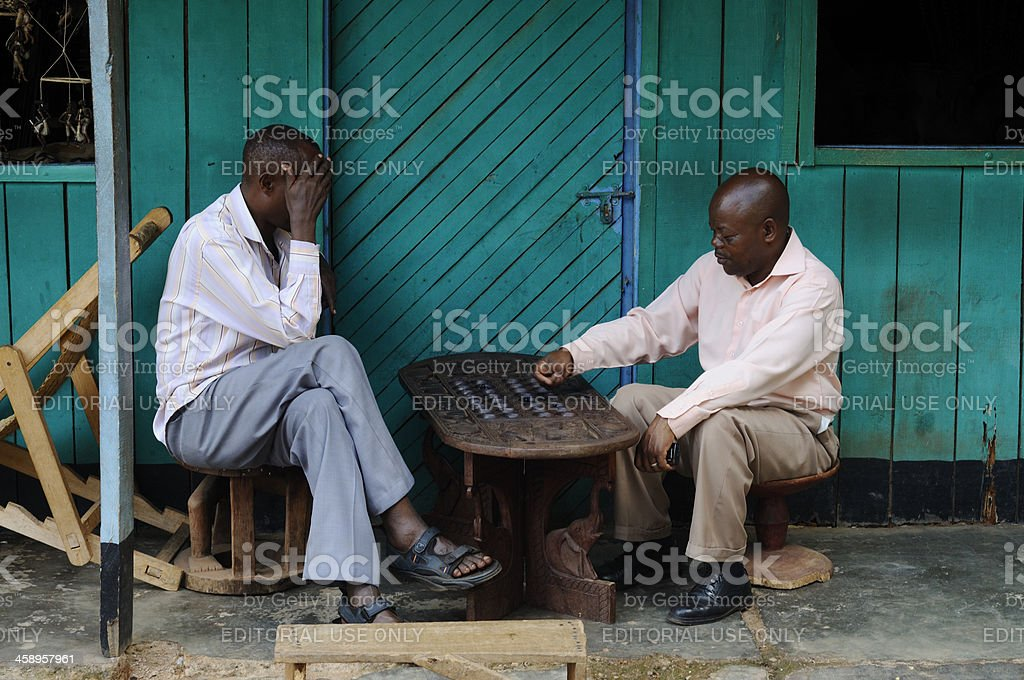 Two Africans playing boa board game stock photo