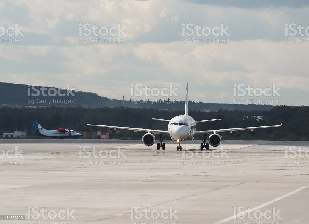two aircraft on runway on  sunny summer day stock photo