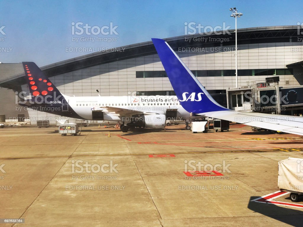 Two  aircrafts near the terminal at Zaventem Airport,Brussels stock photo