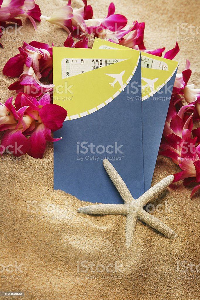 two airline tickets and a lei royalty-free stock photo