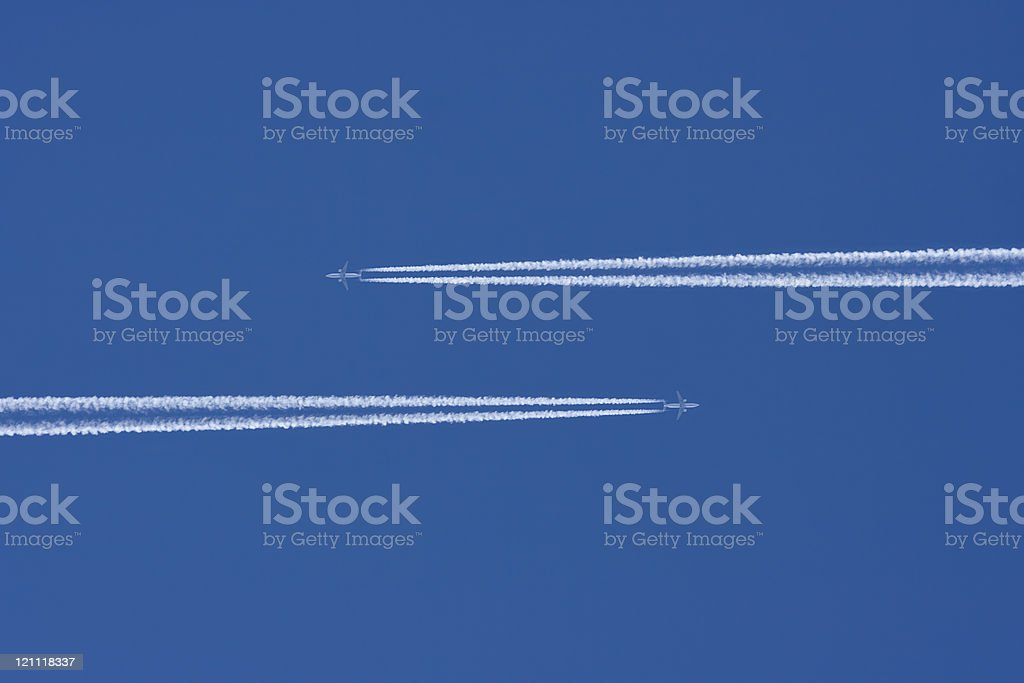 Two Airplanes in a Blue Sky with Vapor Trail royalty-free stock photo