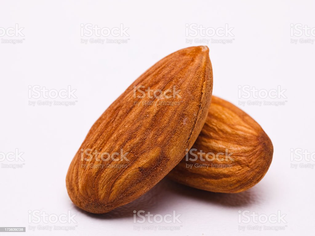 Two almonds stacked on a white background royalty-free stock photo