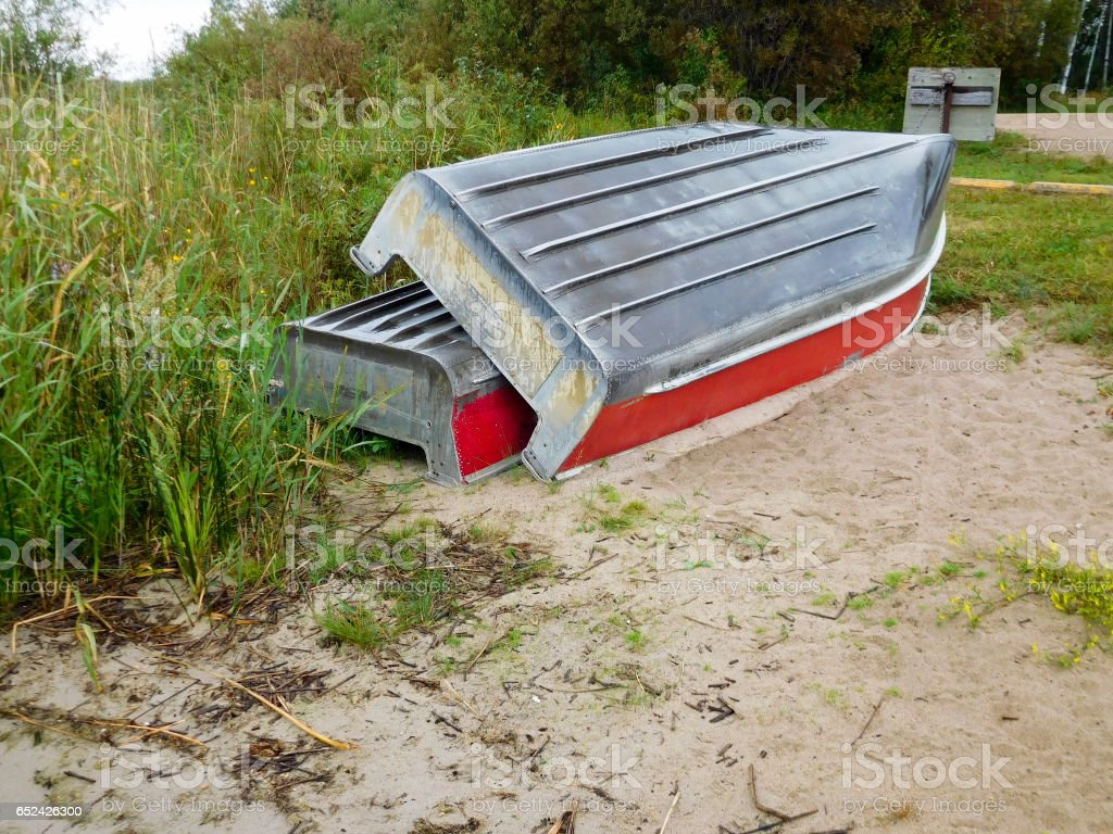 Two aluminum boats pulled up on shore stock photo