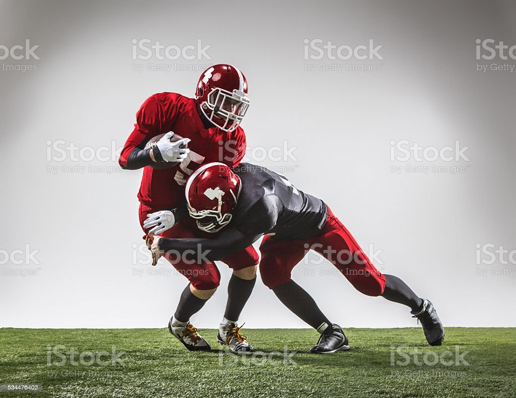 Two american football players in action stock photo