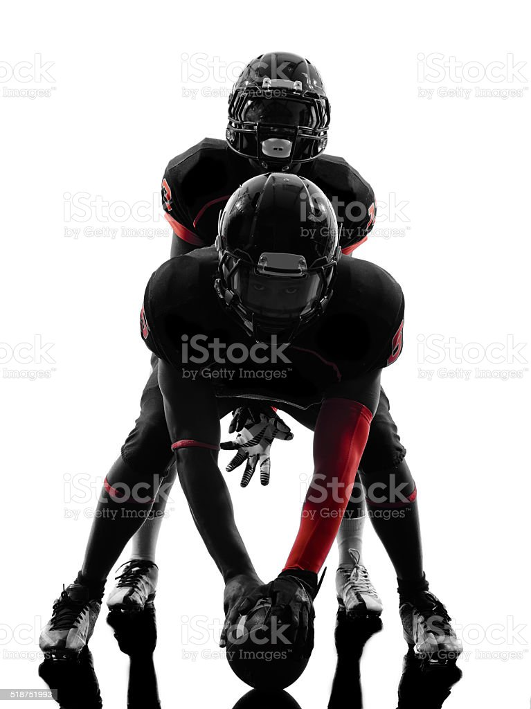 two american football players on scrimmage silhouette stock photo