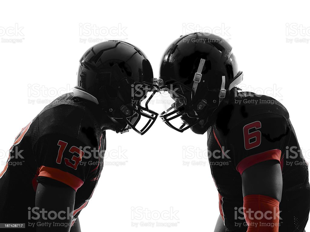 Two American football players squaring up stock photo