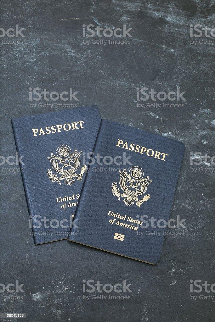 Two American passports on black backgound stock photo