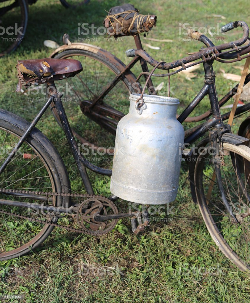 two ancient rusty bicycles for the transport of milk i stock photo