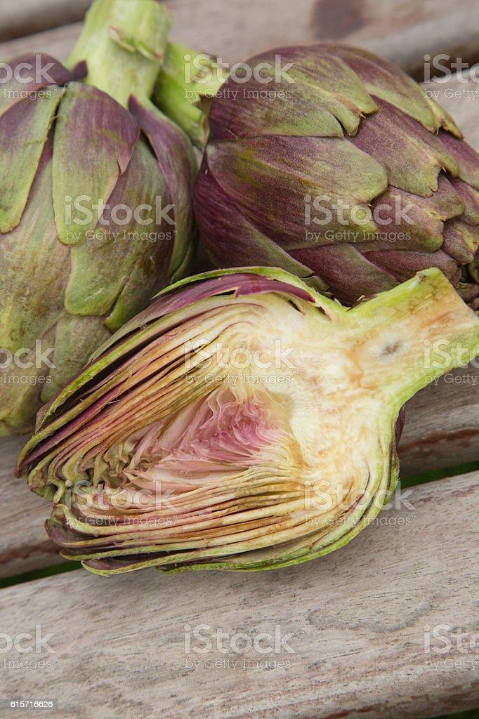 Two and a half artichokes stock photo