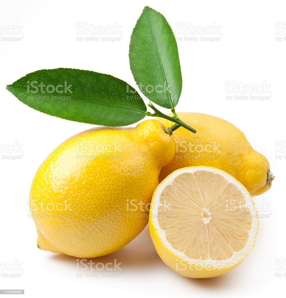 Two and a half lemons and a green leaf royalty-free stock photo
