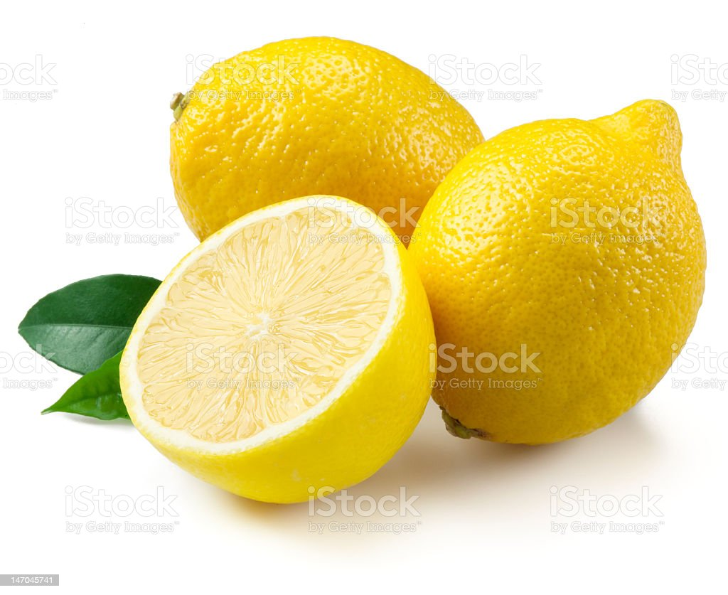 Two and a half lemons on white background stock photo
