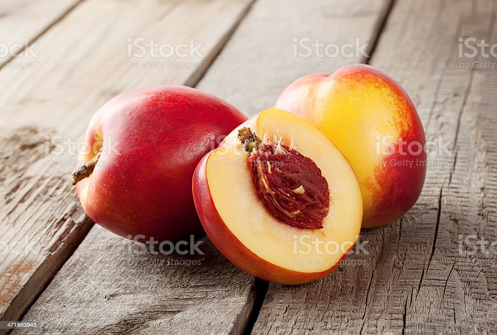 Two and half nectarine stock photo