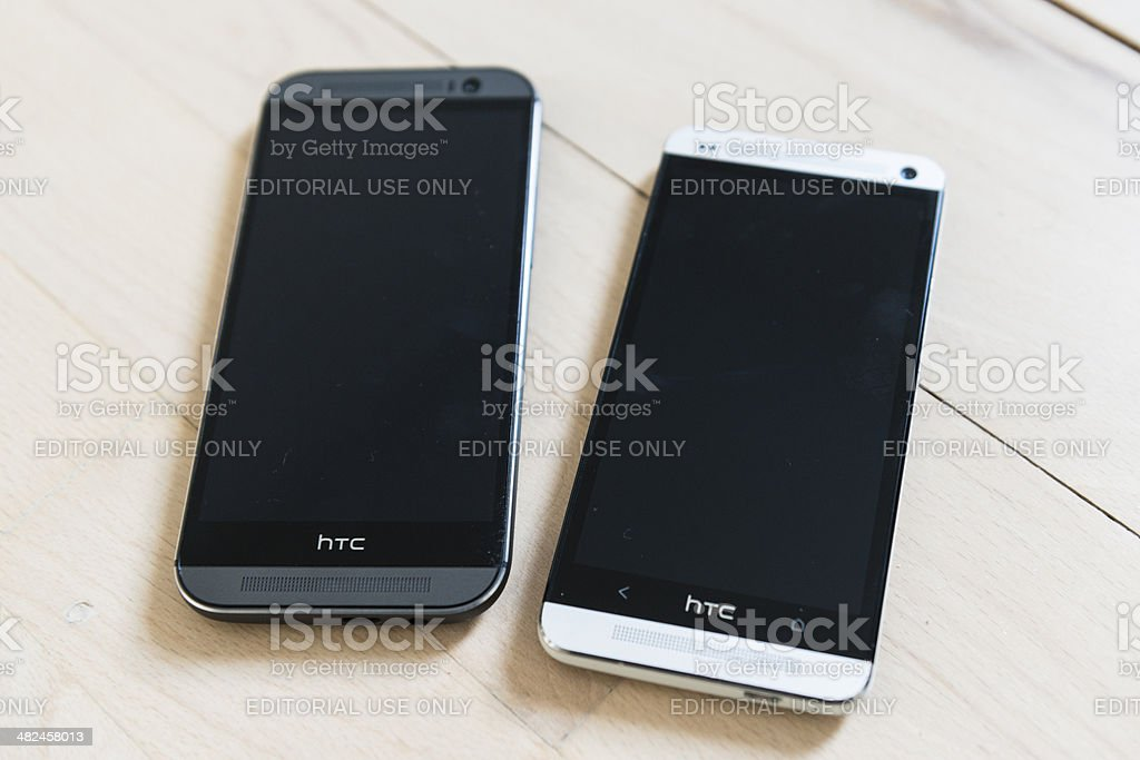 Two Android phones from HTC - One M7 and M8 stock photo