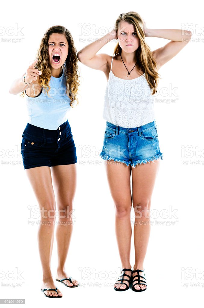 Two angrily horrified young beauties protesting against something stock photo