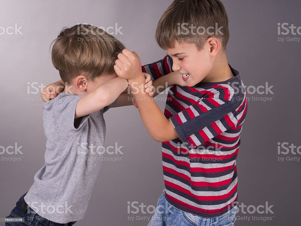 Two angry brothers fighting eachother stock photo