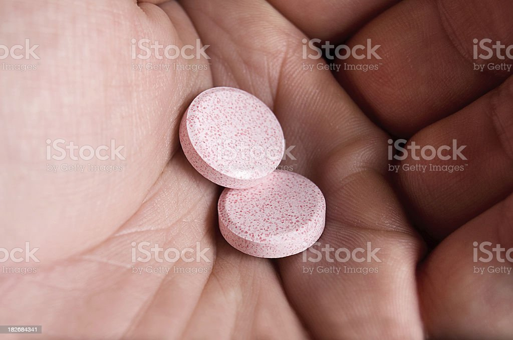 Two Antacid Chewables in Hand stock photo