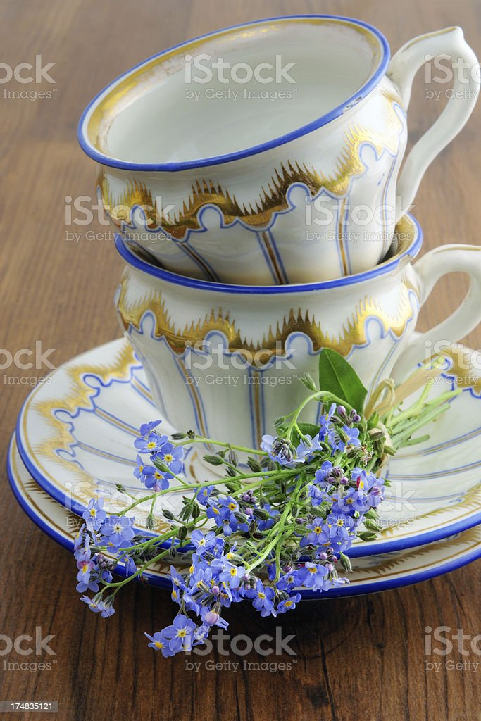 two antqiue Biedermeier coffee cups with bunch of dont-forget-me flowers royalty-free stock photo