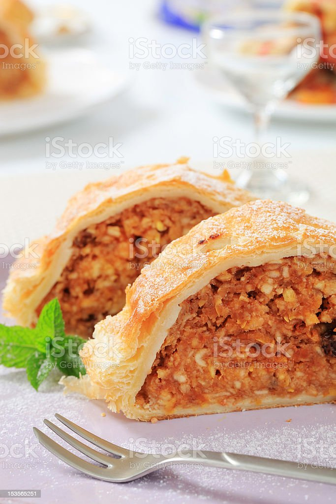 Two apple strudel pieces on a plate stock photo