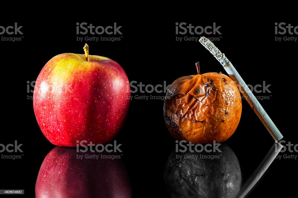 two apples and a cigarette stock photo
