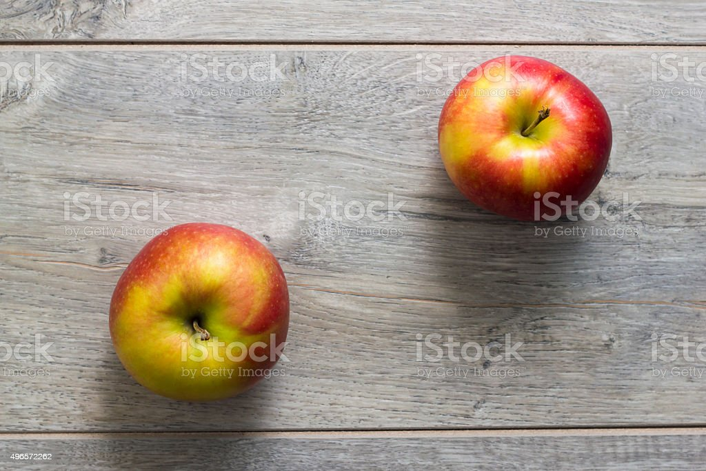 Two apples on wooden table stock photo