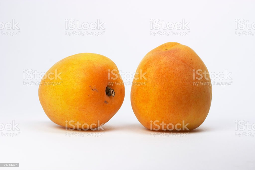 two apricots on white background stock photo