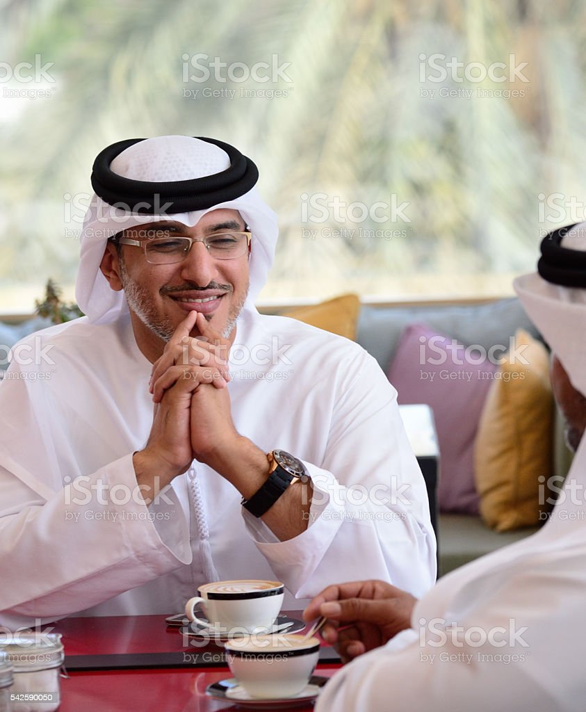 Two arab business men in cafe stock photo