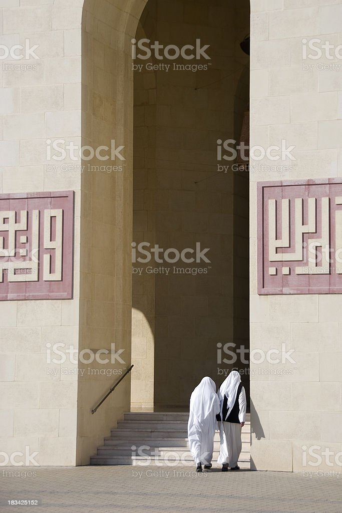 Two Arab Men entering a Mosque stock photo