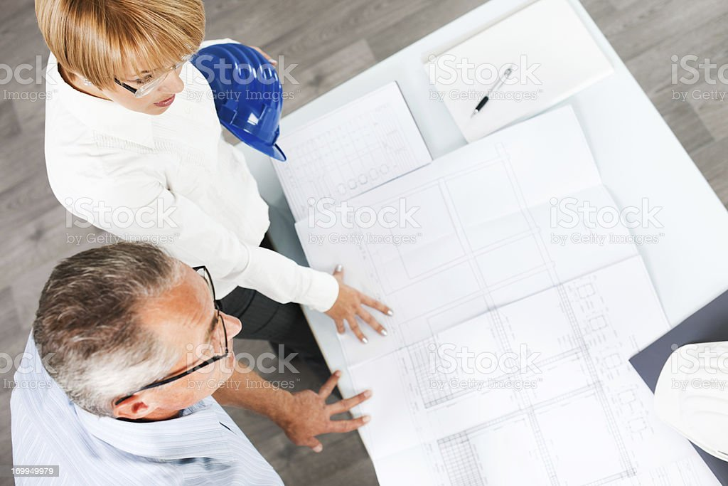 Two architect looking at the project. royalty-free stock photo