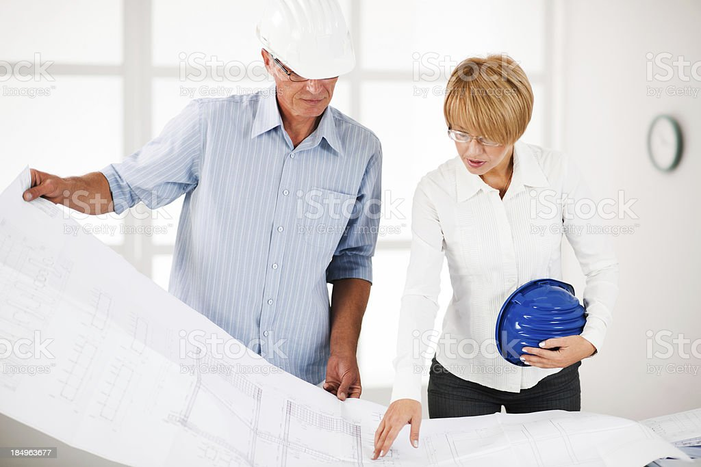 Two architect looking at the project royalty-free stock photo