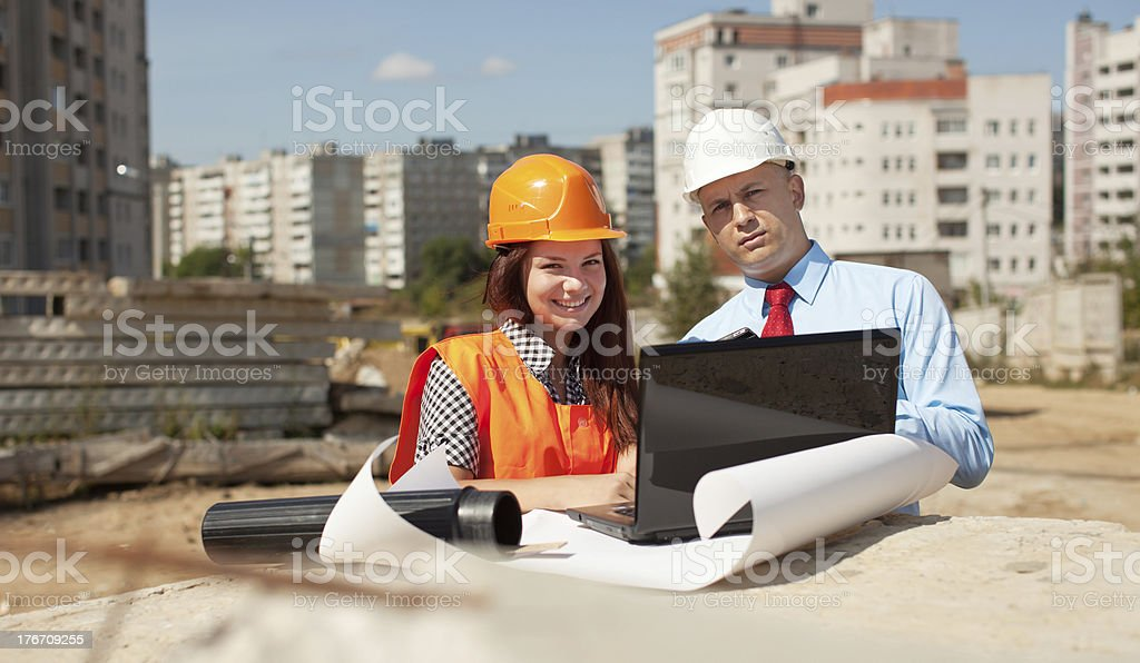 Two architects in front of building site royalty-free stock photo