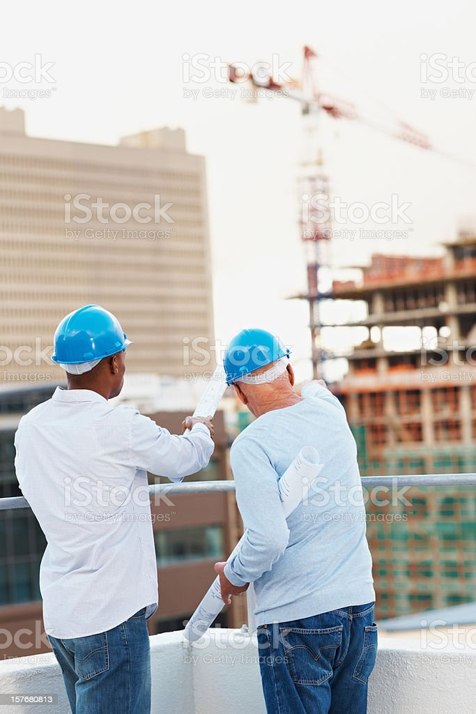 Two architects with their projects while working together royalty-free stock photo