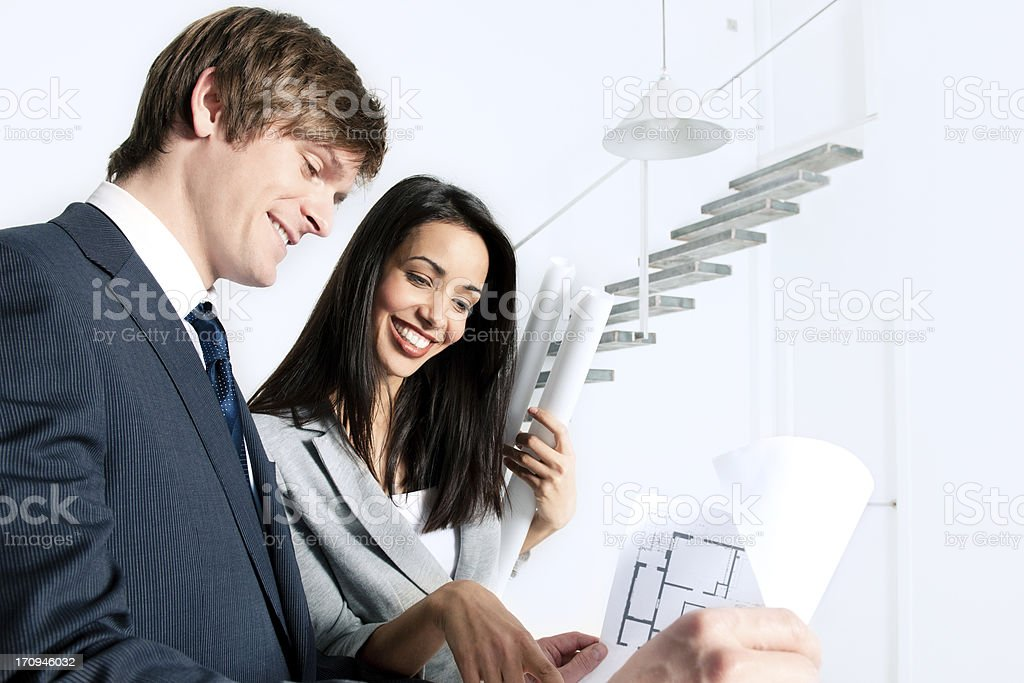 Two architects working on blue prints royalty-free stock photo
