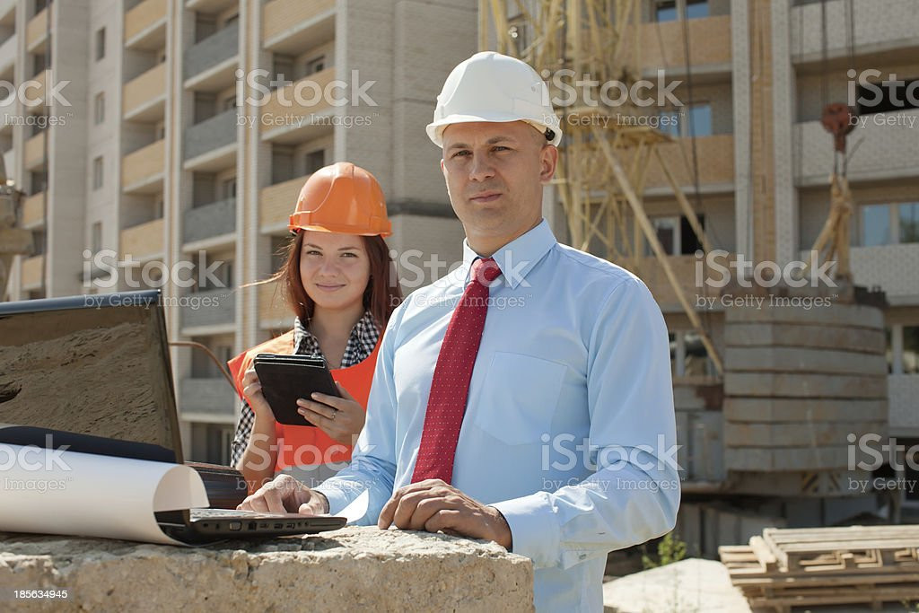 Two architects works in front of building site royalty-free stock photo