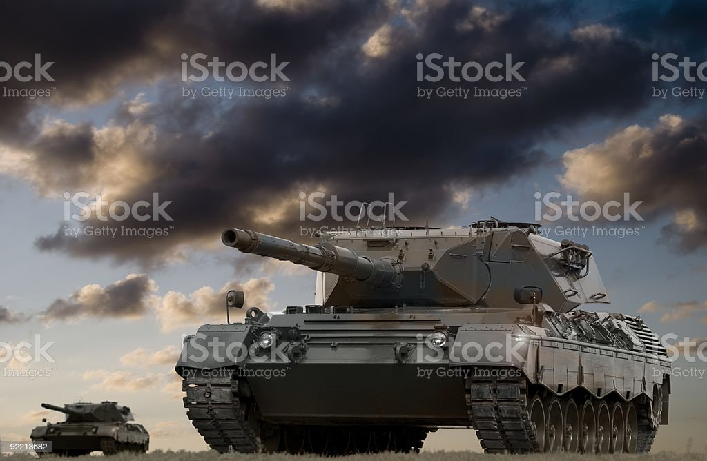 Two army tanks on a cloudy day afternoon stock photo