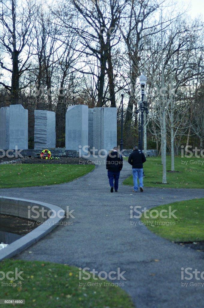 Two Army Veterans Walking in Vietnam Veteran Memorial Park stock photo