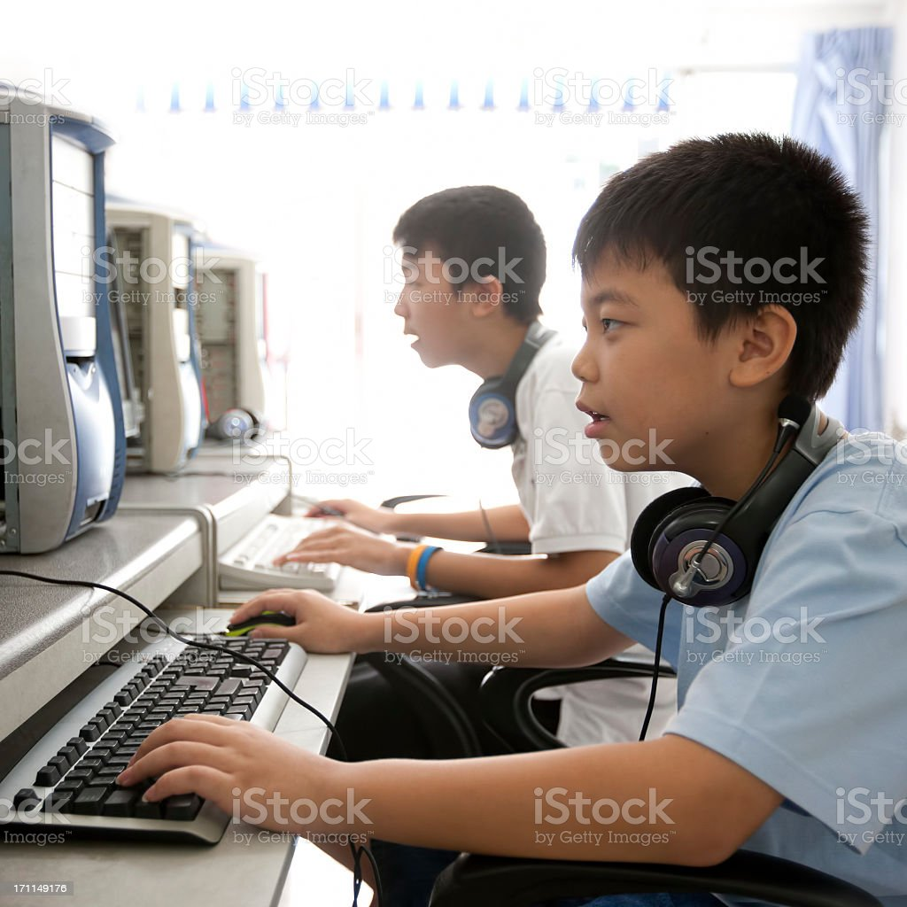 Two Asian boys in an internet cafe. royalty-free stock photo